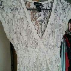 White lace v neck top Lace with flower pattern. Very feminine and cute Tops Blouses
