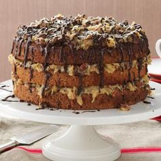 German Chocolate Cake Recipe -This cake is my husband's favorite! Every bite has a light crunch from the pecans, a sweet taste of coconut and a drizzle of chocolate.  —Joyce Platfoot, Wapakoneta, Ohio