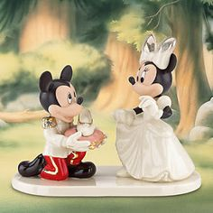 Mickie and Minnie wedding cake topper by Lenox...wouldn't actually top my cake with this but I love it!