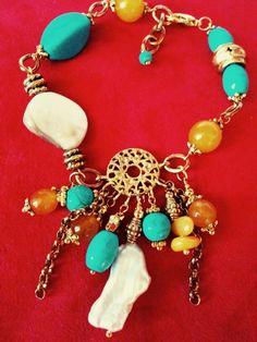 Turchese ,perla,madreperla e ambra in un unico bracciale...