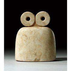 "A Calcite Eye Idol, Tell Brak (Syria), c. late 4th Millennium B.C., 3 15/16"" high."