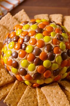 Reese's Peanut Butter Ball  - Delish.com can make it look like a pumpkin with all orange and use brown for design/face or yellow for glowing face JKR.