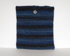 This handmade blue crochet tablet case will keep your iPad or other 9 inch tablet cozy and help to protect it from dust and scratches. The color