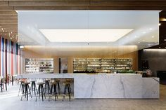New York–based firm Jaklitsch/Gardner Architects designed the 6,700-square-foot outpost of Korean luxury boutique My Boon in Seoul's Gangnam-gu neighborhood. The bright café and juice bar features a marble counter, stainless-steel shelving, lighting bordered with white gradient glass, and wood-paneled walls, all of which serve as a counterpoint to the darker industrial decor throughout the rest of the store. 1F, 4-1 Cheongdam-dong; myboon.co.kr