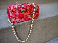 DIY: turn an eyeglass case into a cute evening purse by simply adding a necklace as straps!