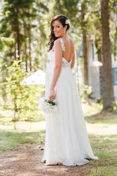 Pregnant bride, wedding dress with open back