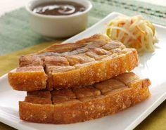 Filipino super crispy lechon kawali - fried belly pork served with pickled young papaya