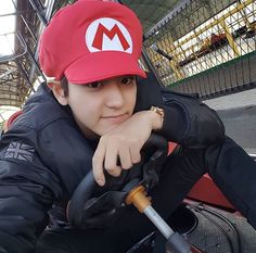 Chanyeol playing real like Mario Kart..  I'm depressed now.. I love Mario Kart!! I saw a meme where a girl rigger her WII to a projector and played on the sode of her two-story house..  that's living properly..