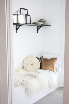 Love the sequined pillow against the fur throw... very Lux /glam