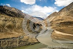 The Indus River flows through the Himalayman Mountains in the Indian province of Ladakh
