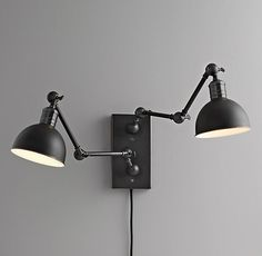 "Double Swing-Arm Tipton Sconce Finish: black   Back Plate: 5""W x 9½""H Extends up to 23"" from wall Uses 2 60W bulbs"