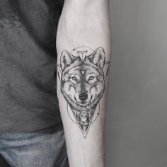 blackwork wolf with geometry tattoo on forearm by emrahozhan