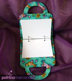 A purse mini binder scrapbook.