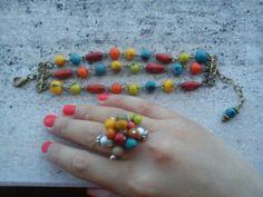 Conjunto pulseira e anel.