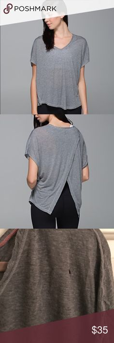 Rare!! Lululemon Devout open back tee!! Size 8!! Small hole near right shoulder and stain  as depicted super cute and rare lululemon athletica Tops
