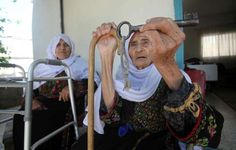 A 102-year-old Palestinian woman holds the key of her family home in the village of Iraq al-Manshiyya, in what is now Israeli-occupied Palestine, on May 14, 2013. She now lives in al-Aroub Palestinian refugee camp, just north the West Bank town of Hebron.