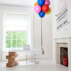 Jenga on one side and baloons on another    Hot-Desk-by-Boys-and-Girls
