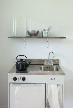 Stovetop/sink/fridge unit for tiny house. So good! From design files I think.