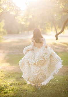 Ruffled Rosette Wedding Dress | Blush Wedding Photography | See More:  http://heyweddinglady.com/liquid-gold-need-magic-hour-portraits-wedding/