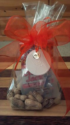 Peanuts and Cracker Jacks with a love quote! Notice the baseball tag that is embossed with our initials and a thank you charm.