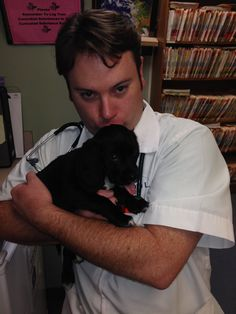 Dr. Travis Cerf holding one of the adoptable puppies at Ridgewood Veterinary Hospital's 7th Adopt-A-Pet Day.