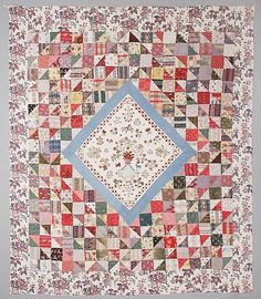 """Patchwork & embroidery by Mary Staveley, East Yorkshire, 1833, central panel embroidered in colored wools, legend: """"I have done this to let you see what care my parents took of me."""" Finished March 8, aged 12 years, 1833, taught at Hannah Wilson, Wetwant, 1833, mosaic of 1830s chintz dress fabrics; 256 x 220 cm"""
