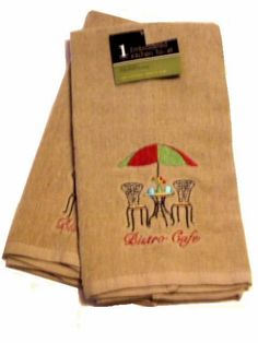This set of 2 embroidered kitchen towels feature a bistro table and chairs complete with umbrella. $15.95