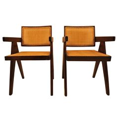 Pair of Pierre Jeanneret amrchairs  France  1955  Pair of original armchairs produced for the Penjab university and administration buildings in the city of Chandigarh.  These armchairs are part of le corbusier's furniture ordered by the indian government for the city in the 50's.