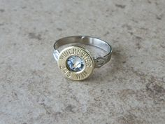 This is a beautiful and unique ring made from spent Winchester 243 brass bullet shell and clear Swarovski crystal inlay and nickel plated adjustable ring