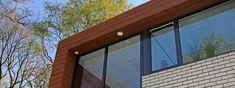 Trespa is a premier developer of high quality HPL panels for exterior cladding, decorative façades and scientific surface solutions. Composite Cladding, Exterior Cladding, Facade, Garage Doors, Windows, Wood, Outdoor Decor, Home Decor, Exterior Siding
