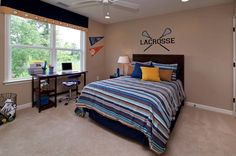 Kids bedroom with carpet and cute blue bedding!