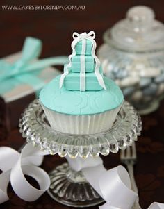Little Tiffany boxes on a cupcake.
