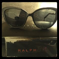 Ralph Lauren cat-eye sunglasses RALPH by Ralph Lauren RA5185 is a Full Rim frame for Women, which is made of Acetate. This model features a Cat-Eye shape, with a Single Bridge. The RALPH by Ralph Lauren RA5185 Sunglasses feature the following logo: The Ralph label is displayed on the temple These Sunglasses work well for people whose style is: Stylish Designer, Retro/Vintage, Cool/Trendy. Ralph Lauren Accessories Sunglasses