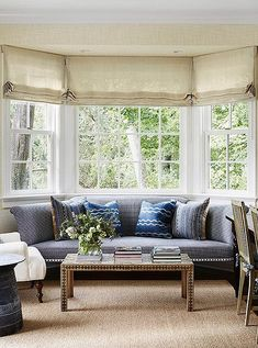Natural Roman blinds and a jute area rug make great neutral foundation pieces for French blue living room furniture and cream accents. Bay Window Treatments, Window Treatments Living Room, Treatment Rooms, Bay Window Living Room, Curtains Living, Living Room Furniture, Living Room Decor, Living Room Designs, Living Rooms
