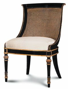 Ebanista. Love the lines & style of this graceful chair.