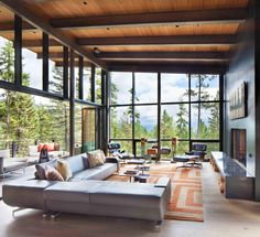 Main sitting area with glass walls in this home in Whitefish Montana. [2000 1827]