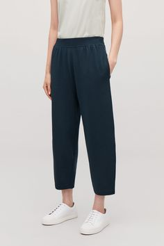 ORGANIC TERRY COTTON TROUSERS - Navy - Trousers - COS Cropped Trousers, Wide Leg Trousers, Woman Reading, Timeless Design, New Product, Organic Cotton, Man Shop, Model, How To Wear