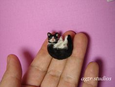 Made by the talented AGZR Studios. This is my favorite miniature cat.