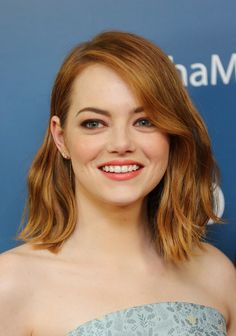 Emma Stone Medium Wavy Cut - Emma Stone styled her hair with a side part and just a hint of wave for the screening of 'Aloha.'