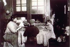 "Lewis W. Hine  American (1874-1940)  DESCRIPTIVE TITLE: Shelling nuts  PUBLISHED TITLE: Mrs. Raphael Marengin, New York City  SERIES TITLE: ""Child Labor"" (Tenements) series  1911"