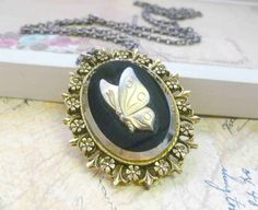 Vintage Butterfly Necklace Gold Cameo 1950s. $25.00, via Etsy.