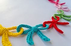 Garland of Colorful Bows Crochet Pattern so pretty and could use colors for holi., Garland of Colorful Bows Crochet Pattern so pretty and could use colors for holidays, like reds and pinks for valentines day decorations. Crochet Diy, Crochet Garland, Crochet Motifs, Crochet Crafts, Yarn Crafts, Crochet Stitches, Crochet Projects, Crochet Patterns, Crochet Christmas Garland