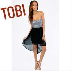 SALE!! TOBI strapless dress This silver and black glitzy dress is fantastic for party-goers! Worn twice. No straps included. Signs of wear of the sheer material shown in last picture. Other than that, in great condition! Tobi Dresses Strapless