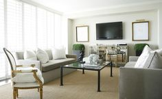 Love the facing sofas and the seagrass rug, from ashelygoforthdesign.com