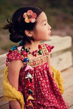 Beautiful colors and paterns on this little girl's dress.
