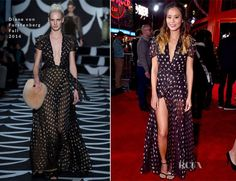 Jamie Chung attended the premiere of Disney's 'Big Hero 6′ held at the El Capitan Theatre on Tuesday (November 4) in Hollywood, California.  The actress wore a beautiful Diane von Furstenberg Fall 2014 black gown rendered in light chiffon with a gold-embroidered star print.  The mood was of a slight bohemian nature, with a part-braided 'do accented with a gold chain rounding out her look.  You may remember that Brie Larson wore this same gown to the CFDA Fashion Awards back in June.