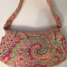 Vera Bradley small purse Vera Bradley small purse.  Pink with darker pink, green & blue accents. Vera Bradley Bags