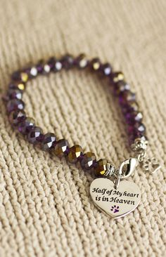 Remember a beloved pet who has moved on with the dazzling touch of crystals and a heartfelt message on our paw print bracelet.