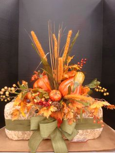 Hay bale arrangement designed by Christine Lucas Crowley for Michaels, Willowbrook, IL 2016 Flower Arrangement Designs, Fall Floral Arrangements, Fall Yard Decor, Fall Home Decor, Harvest Decorations, Thanksgiving Decorations, Autumn Decorating, Fall Projects, Fall Wreaths
