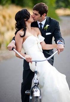 Romantic kiss on bike! #bicycles #wedding